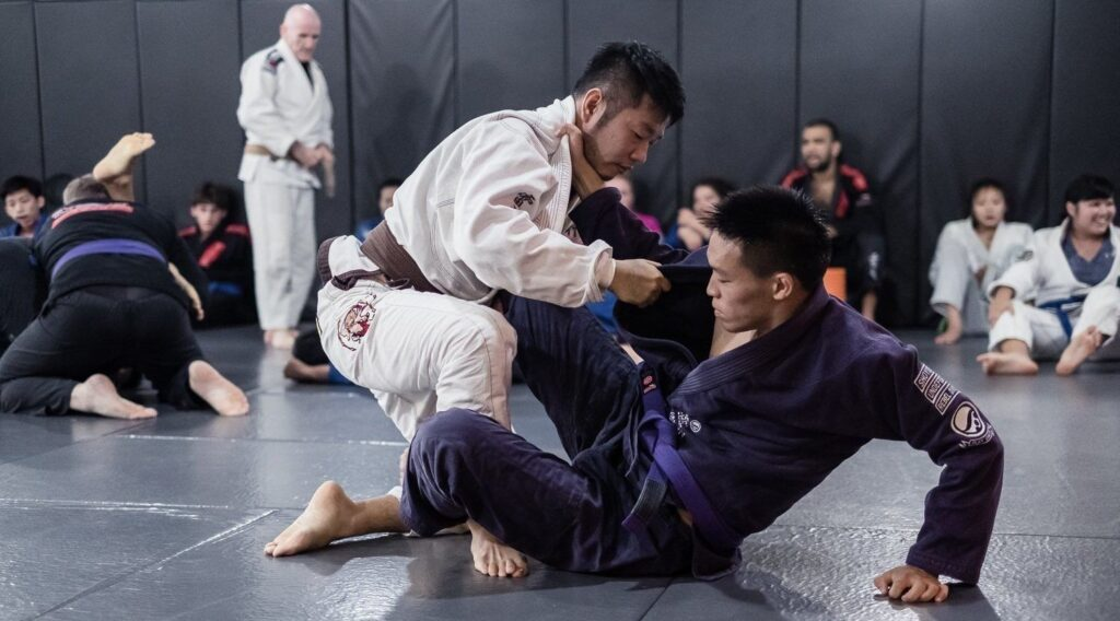 Should You Spar Against Lower Belts Or Higher Belts In BJJ?