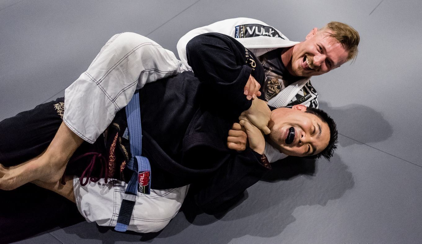 Two BJJ students smiling.