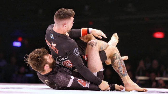 Two BJJ competitors rolling in a match