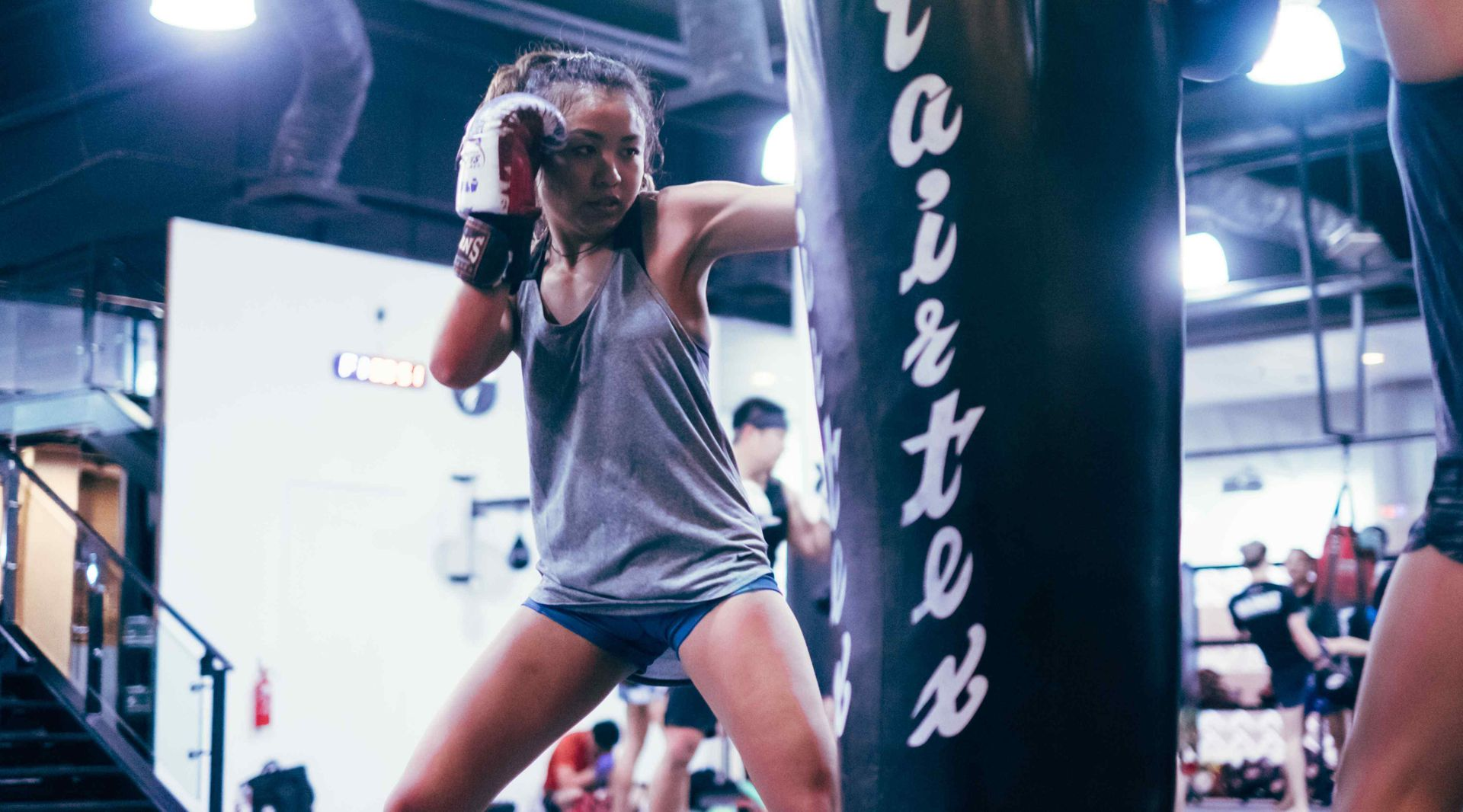 A student hits the heavy bag during a Muay Thai class at Evolve MMA in Singapore.