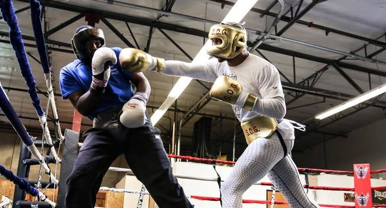 Two boxers sparring during training.