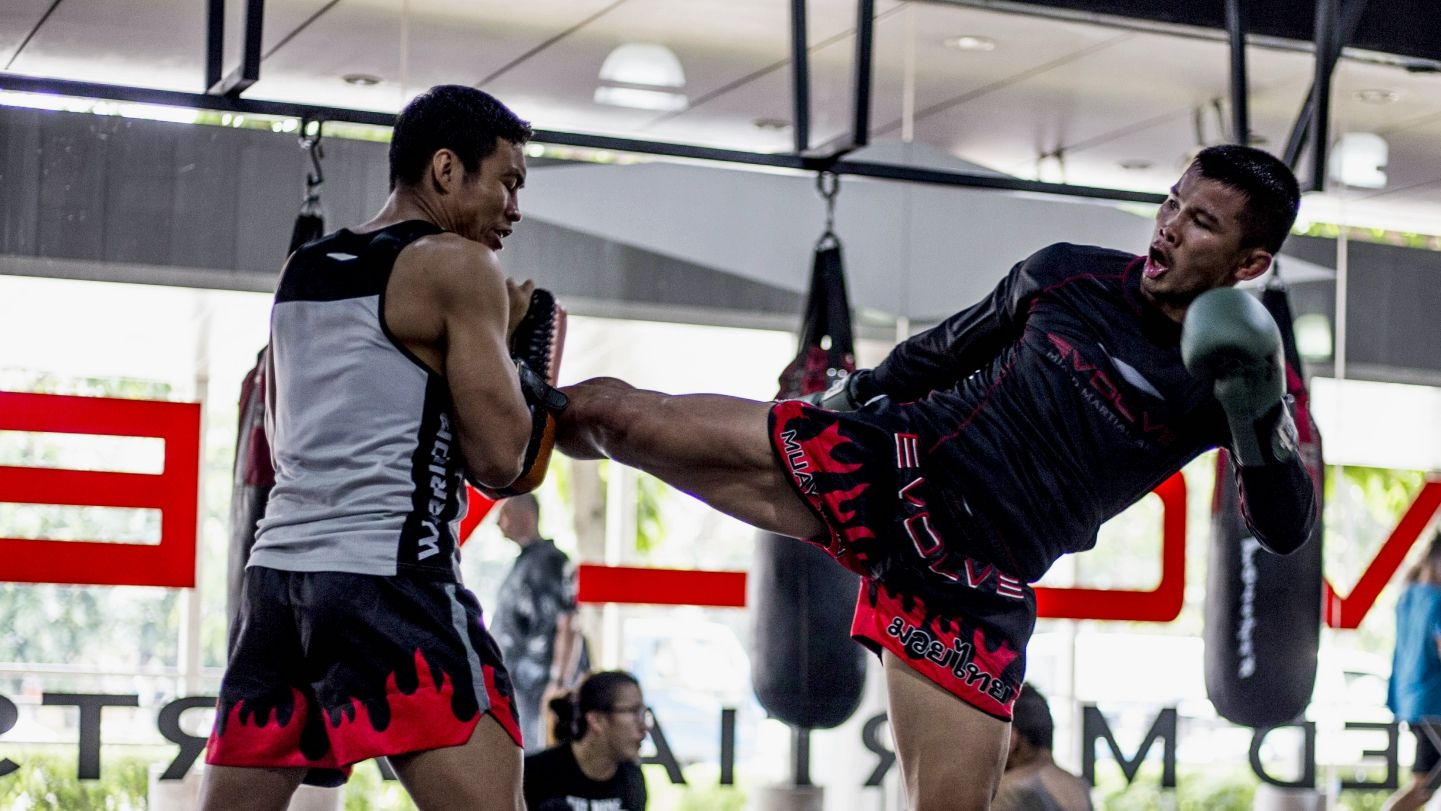 Nong-O kicking the pads during a Muay Thai class