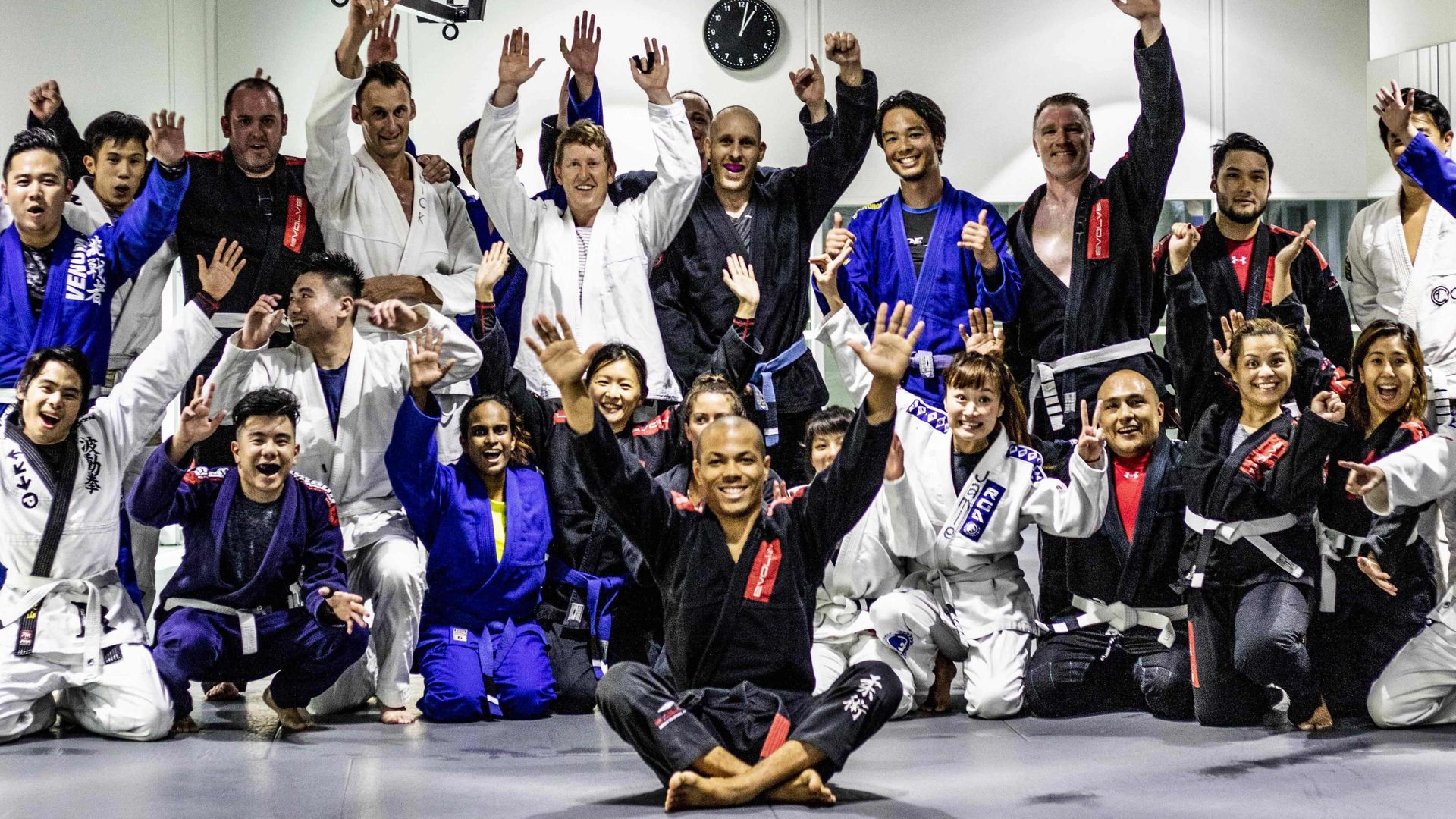 A group of BJJ students cheering