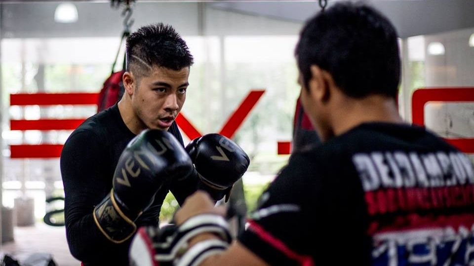 Benjamin Kheng training in a Muay Thai class at Evolve MMA gym.