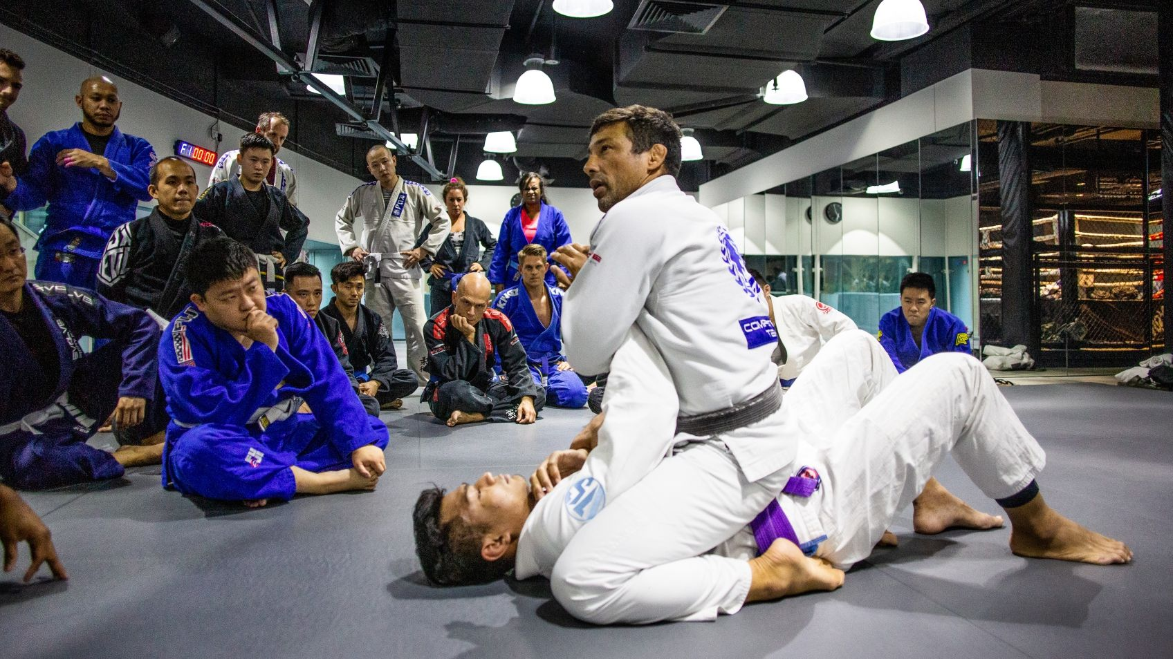 Teco Shinzato teaching a BJJ technique in class