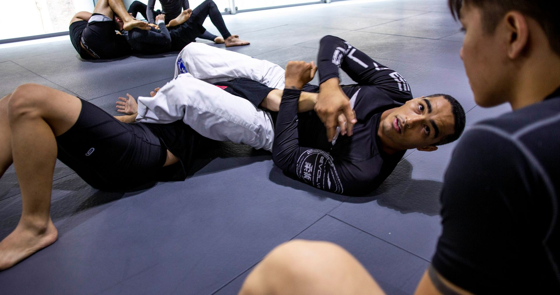 a person performing an armbar in BJJ