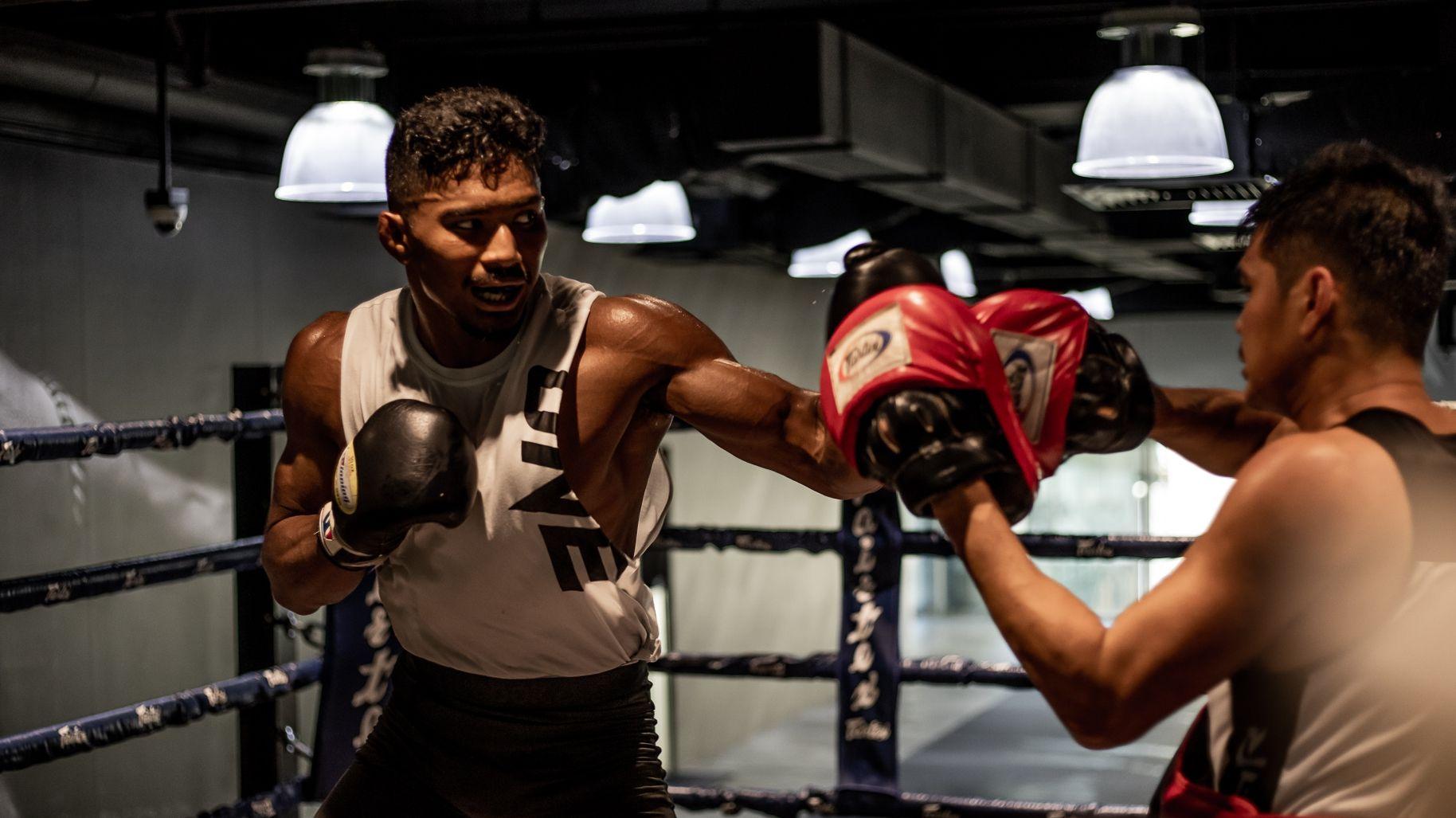 Amir Khan throws a hook in boxing