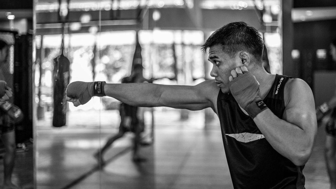 Eko Saputra throws a punch during boxing class.