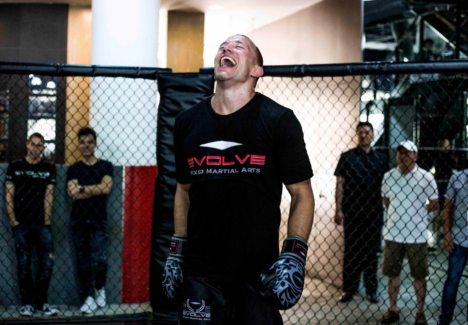 MMA Legend GSP laughs during training at Evolve MMA