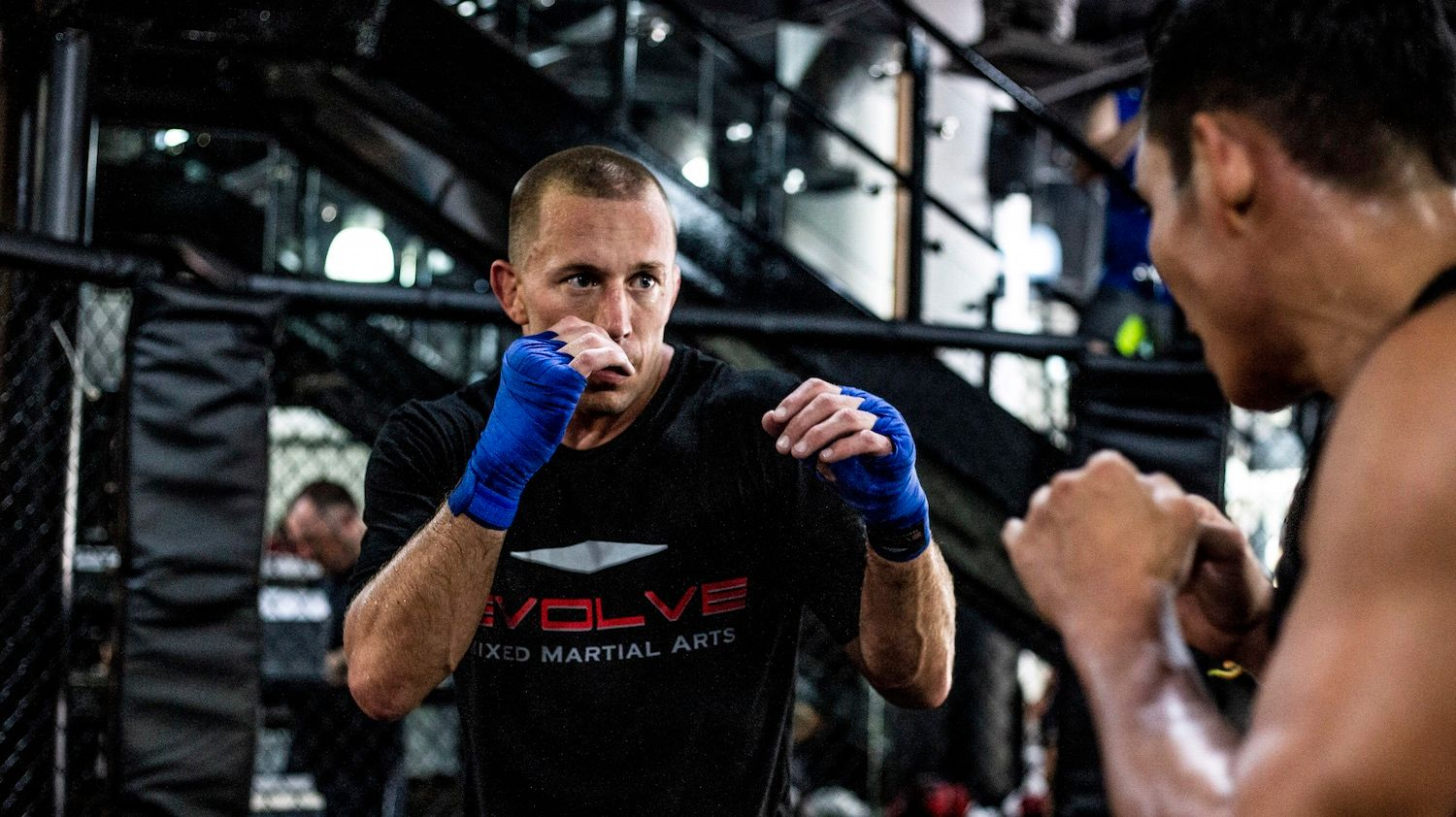 Georges St. Pierre wearing blue hand wraps at Evolve MMA