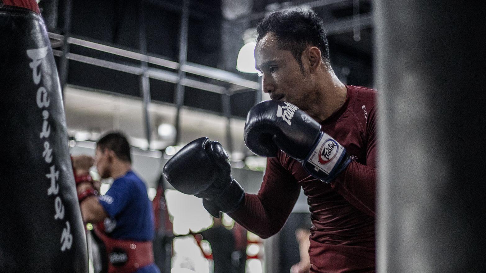 Sam-A training Muay Thai on a heavy bag.
