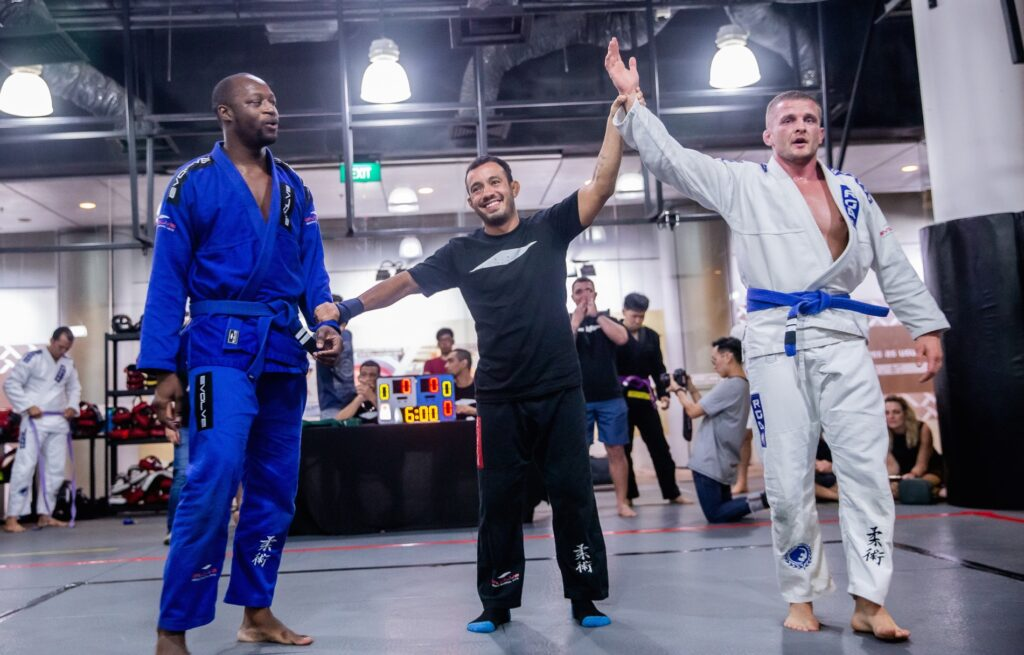 A BJJ competitor with his had raised