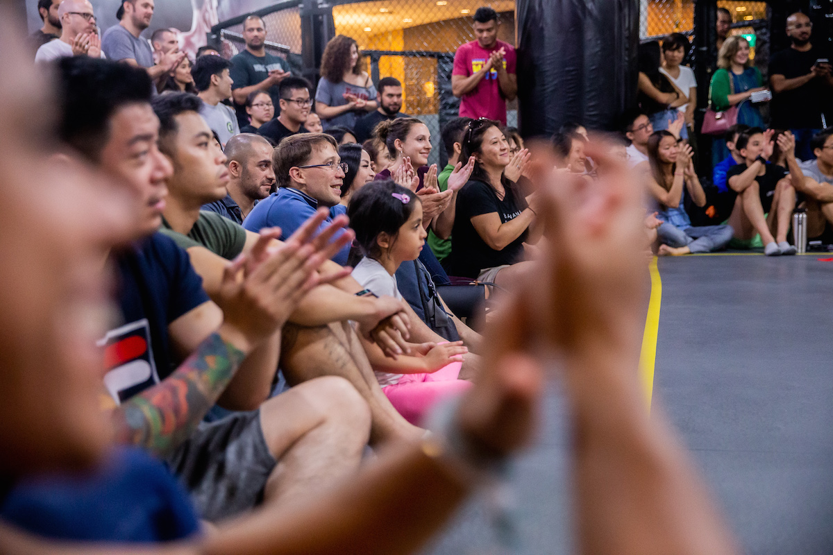 A crowd watching BJJ