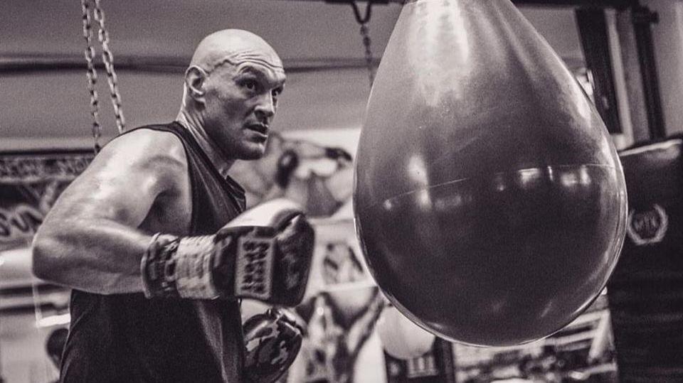 Tyson Fury hitting a heavy bag