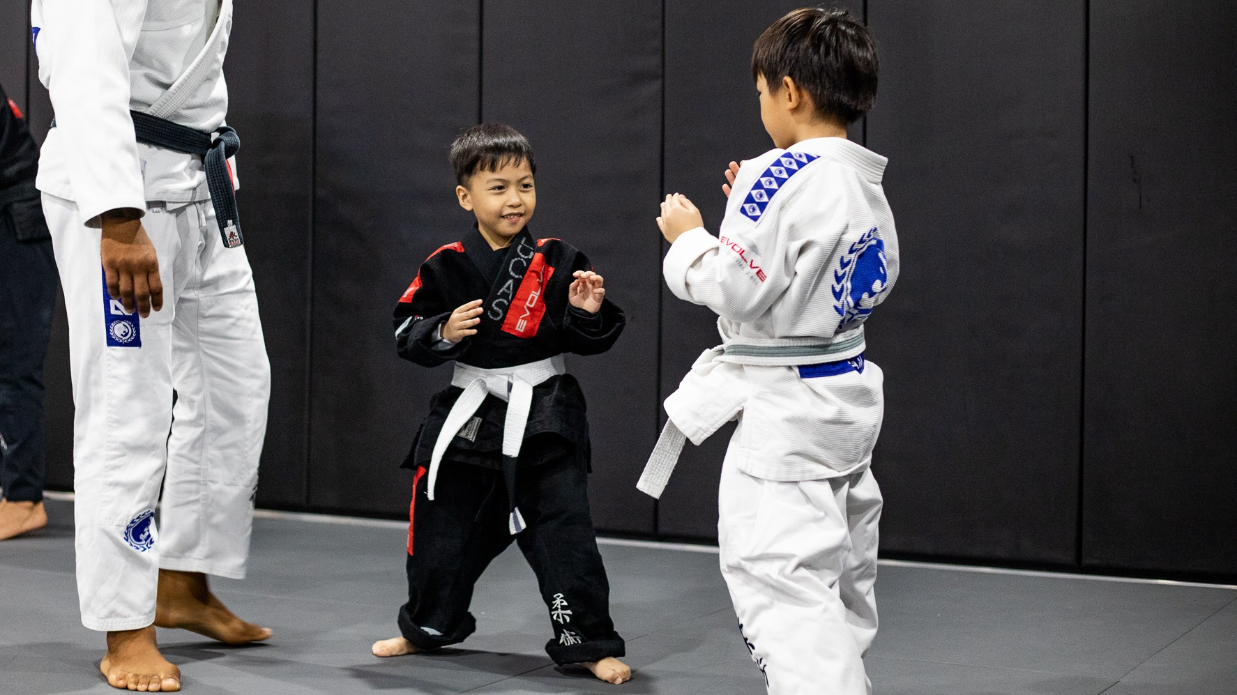 two kids training martial arts