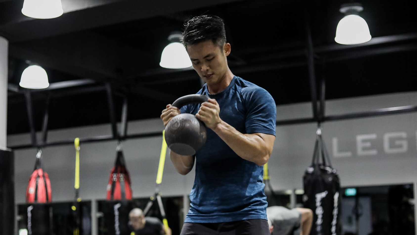 a person carrying a kettlebell