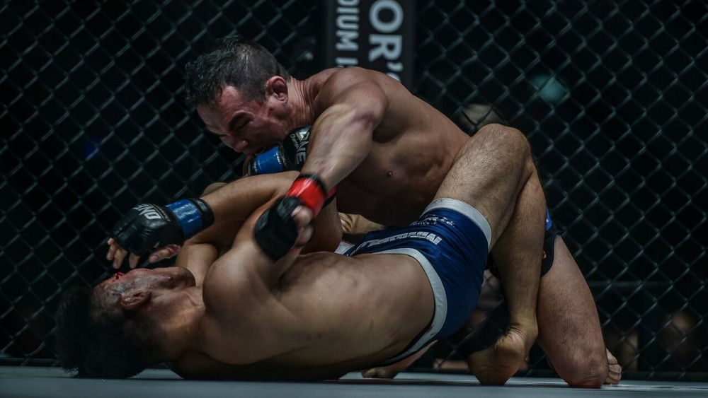 adrian pang ground and pound from guard