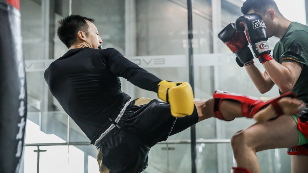 muay thai students sparring in class