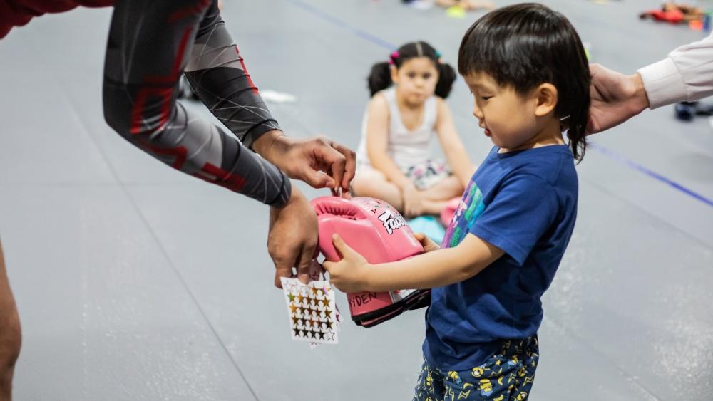 muay thai teaches kid hard work
